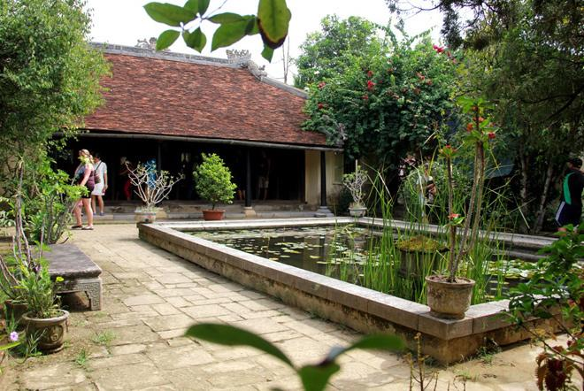The Lotus Pond Or Shallow Pool In Front Of The House Is A Feng Shui  Element. The House Is Surrounded By A Garden.
